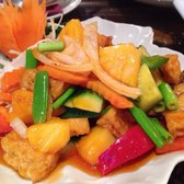 Pad Priew Wan- stir-fried veg & tofu in a sweet & sour sauce mixed w/ onions, red & green peppers, cucumber, tomato & pineapple
