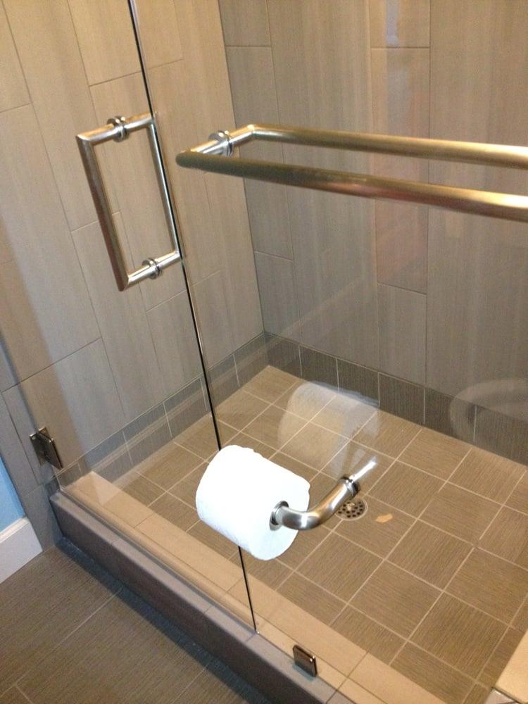 Toilet Tissue Holder Thru The Fixed Panel On A Frameless