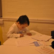 A student completing his maths tuition at the Solihull Tudor Grange Kumon Tuition Centre