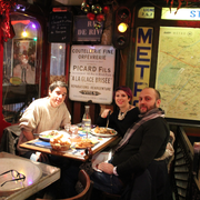 Le Tambour - Paris, France. Us at the table. The waiter was so kind and asked us if we wanted a picture together!