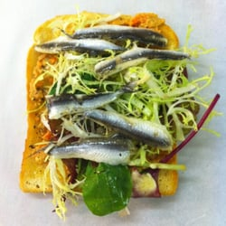 brown crab and white anchovy on toast