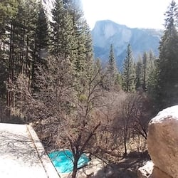The Ahwahnee - Room 502 roof deck view of swimming pool with Half Dome in the background - Yosemite National Park, CA, Vereinigte Staaten