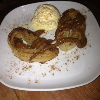 Deep fried cinnamon infused pastry with chocolate and toffee sauce - oh and I've cream!