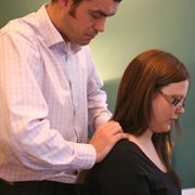 Sundial Chiropractor examining neck and…