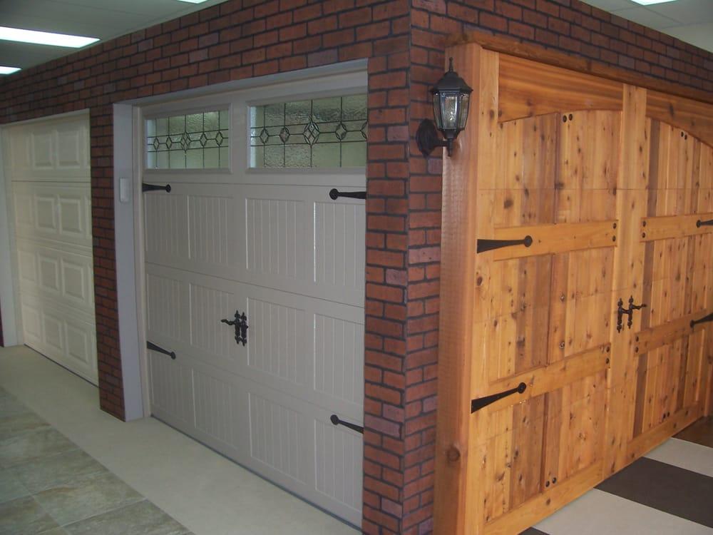 Our showroom displays all our garage door models colors for Garage doors plano