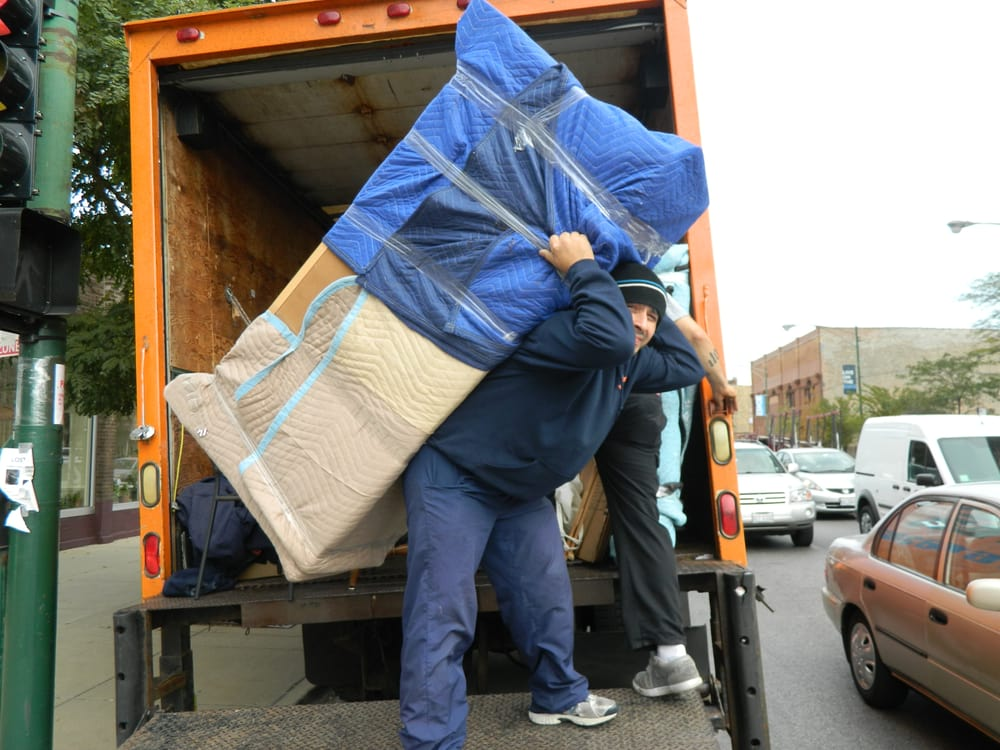 Wolley Movers on the job - unloading furniture.