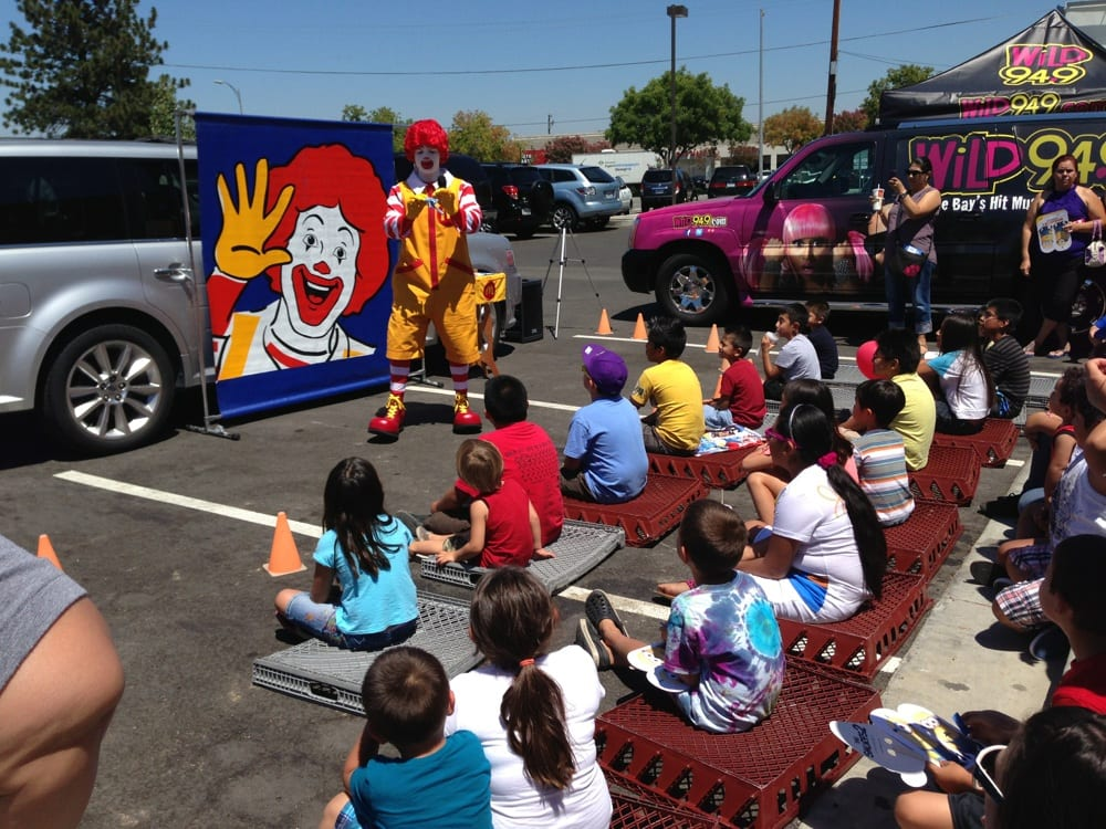 Ronald McDonald giving a free show to the kids! Wild 94.9 was also ...
