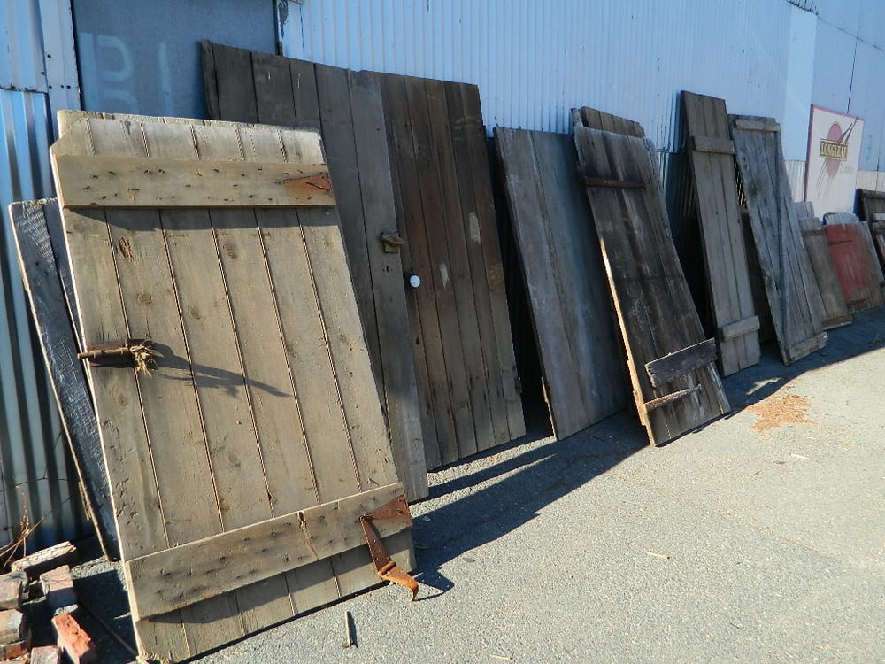 Reclaimed barn doors for sale at our cambridge retail for Recycled wood flooring for sale