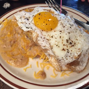 ... breakfast burger on sourdough with cheddar, sausage gravy and an egg