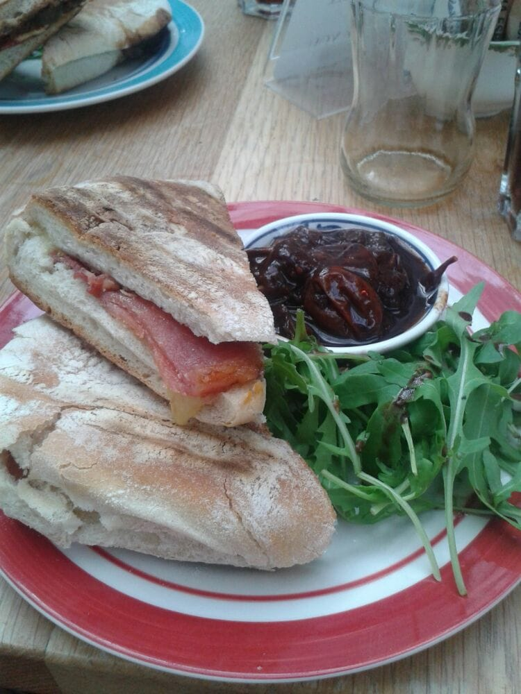 ... , United Kingdom. cheese & bacon toastie with tomato chutney (2014