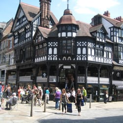 This image shows Chester Cross, which is situated at the junction of Bridge Street, Watergate Street and Eastgate in Chester. It
