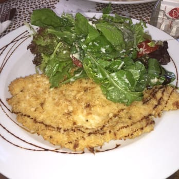 ... Chicken Milanese. Lightly breaded crispy chicken with arugula salad