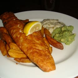 fish and chips - beer battered haddock with chips, minted mushy peas and tartare