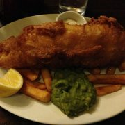 Now that is a fish and chips. Not sure what the green stuff is though. #dumbamerican