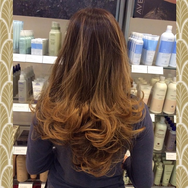 Sunlight blonde balayage highlights melted on a golden for A la mode salon brooklyn
