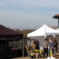 Saturday market with skyline views