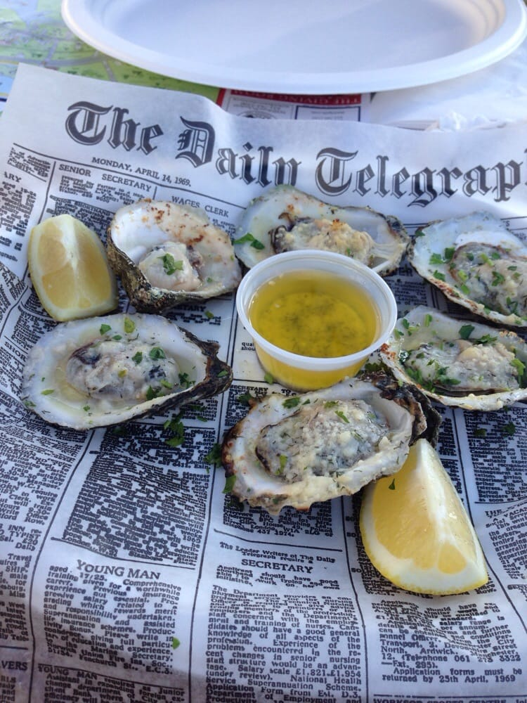 Charbroiled oysters w garlic butter sauce yelp for Southold fish market