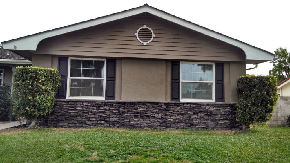 After paint stucco over brick and stacked stone yelp for Stucco modular homes