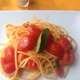 Spaghetti with marinara, fresh cherry tomatoes, and basil