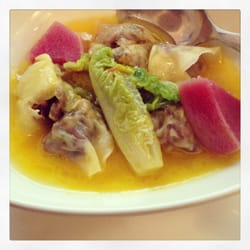 Pork stuffed pasta with beets and wilted romaine in a buttery broth.