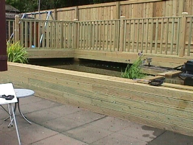 Decking incorporating a fish pond yelp for Koi pond builders east rand