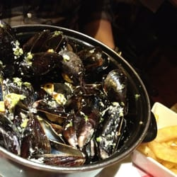 Le Bruant - Paris, France. Pot of mussels with white cream sauce