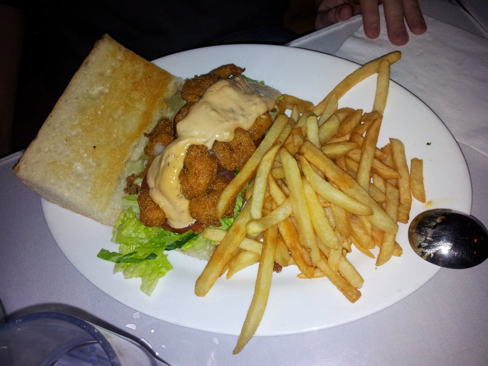 Cornmeal-fried Shrimp Po'Boy with chipotle remoulade on toasted French ...