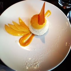 Lime cheesecake with mango and coconut