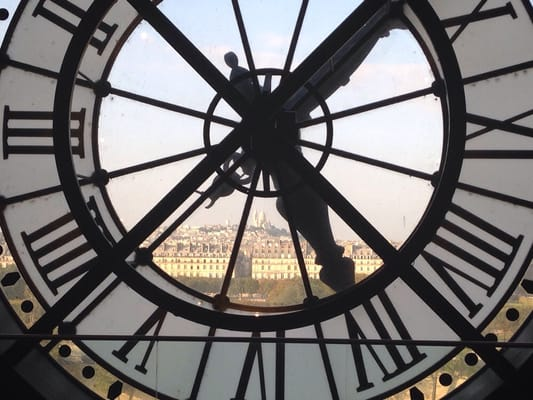 View of Montmartre and Sacred Heart from the inside through the famous clock.