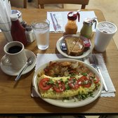 ... omelette with potatoes and toast; black coffee; Mexican hot chocolate
