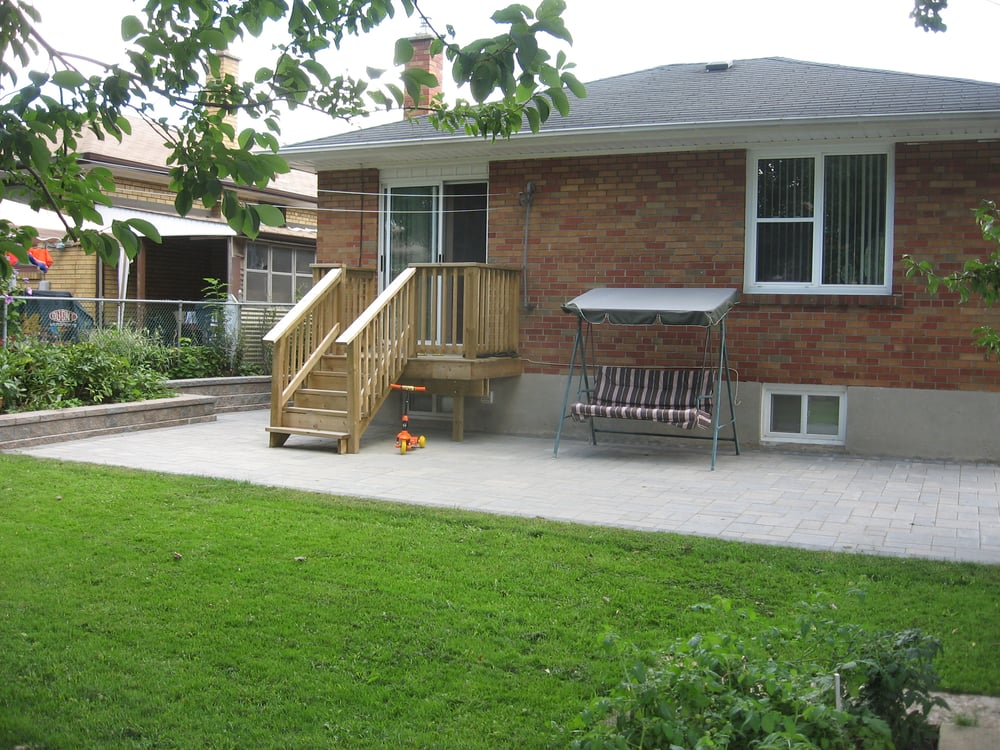 back patio wood deck and steps and small retaining wall