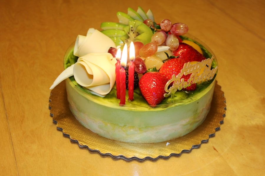 ... . Green Tea Mousse Cake with fruit toppings and white chocolate roses