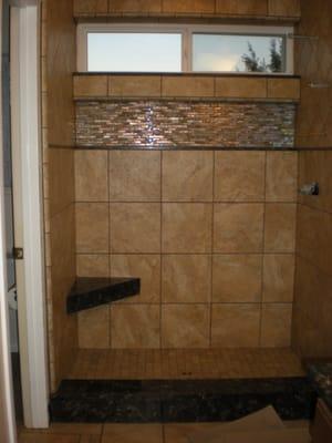 porcelain tile shower with quartz seat, curb, shelf and