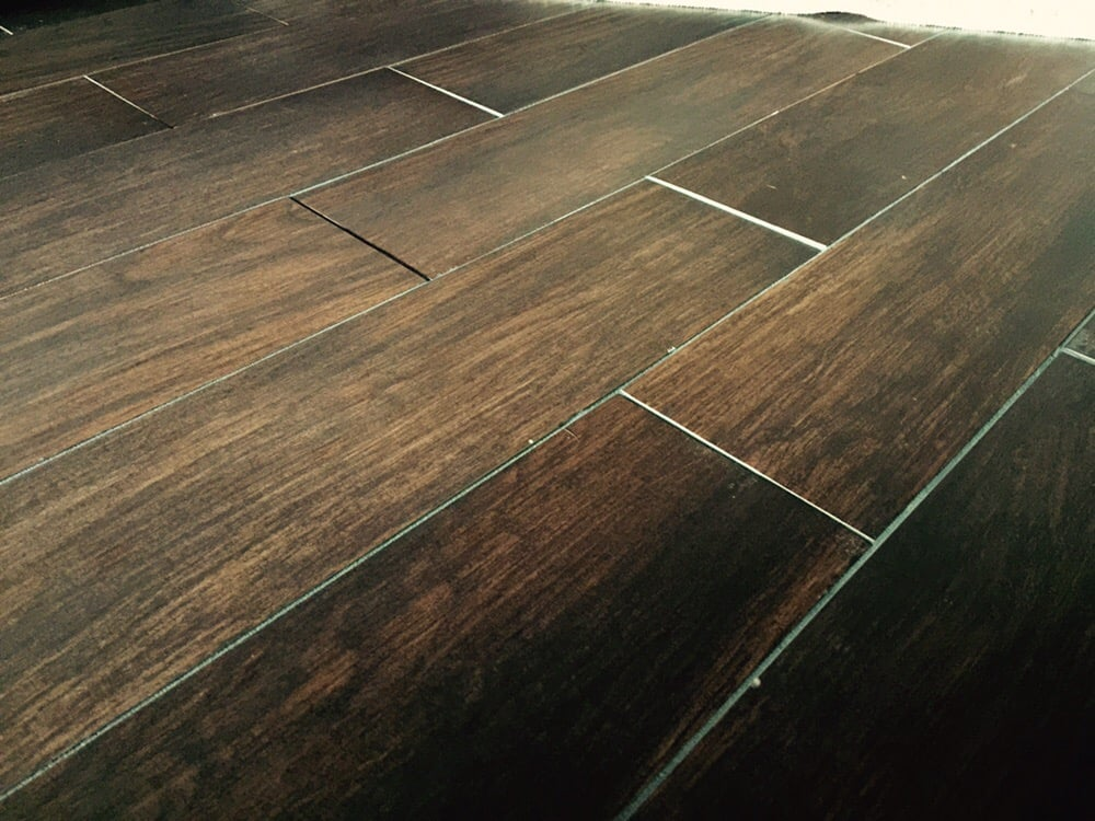 Uneven wood look tile yelp for Hardwood floors uneven