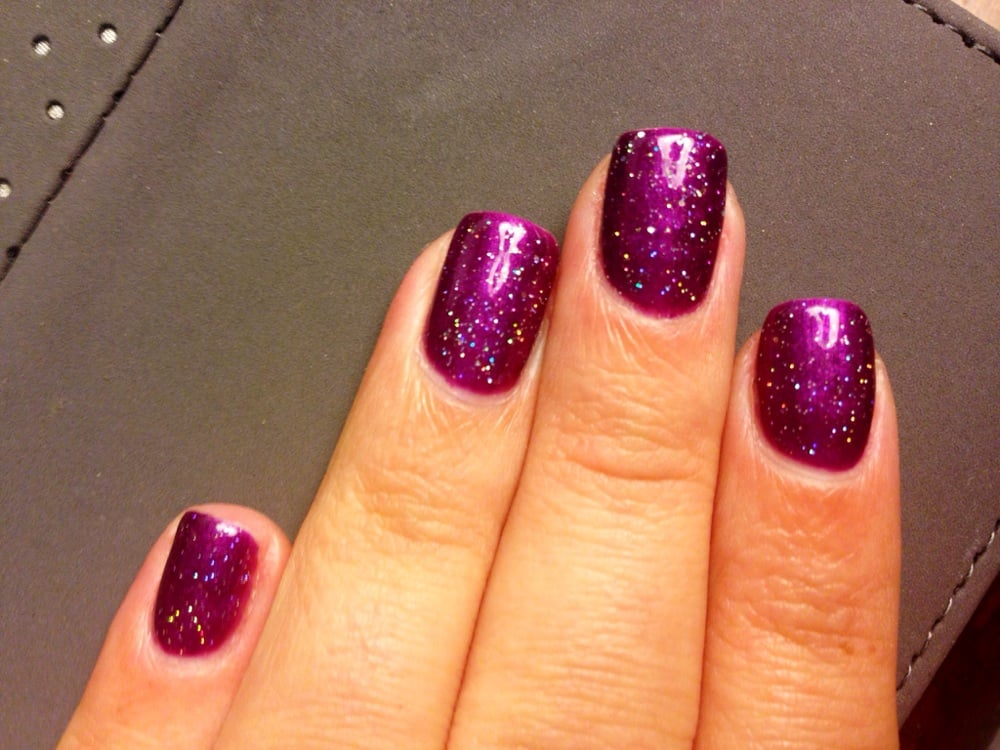 Purple shellac & multi color glitter shellac on top On my real nails