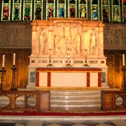 Holy Trinity, Sloane Square: Altar. Wall hangings either side are by William Morris