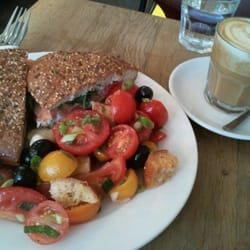 Smoked salmon sandwich, heritage tomato salad, and a soy latte