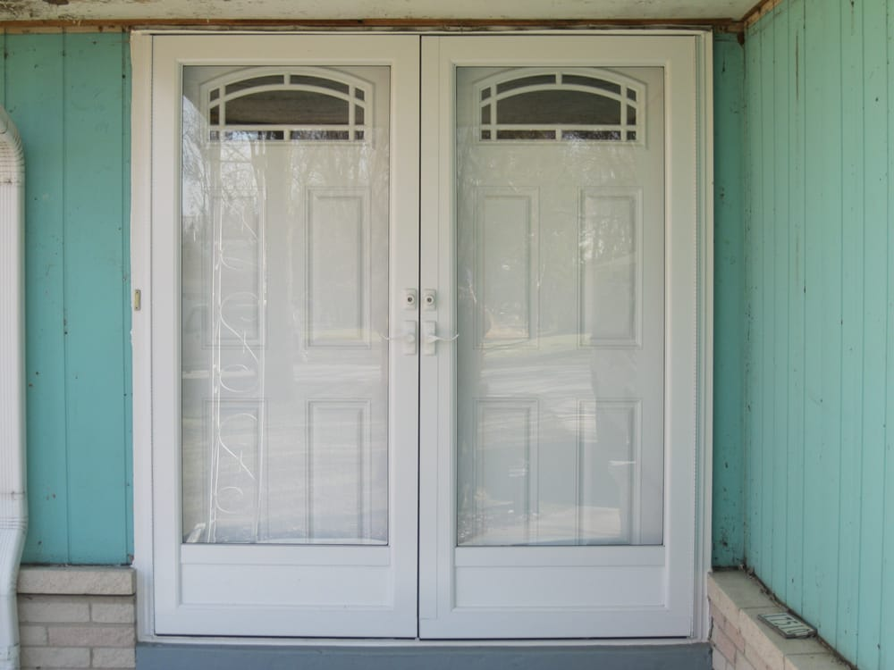 We replaced the double entry doors with new fiberglass for Storm doors for double entry doors