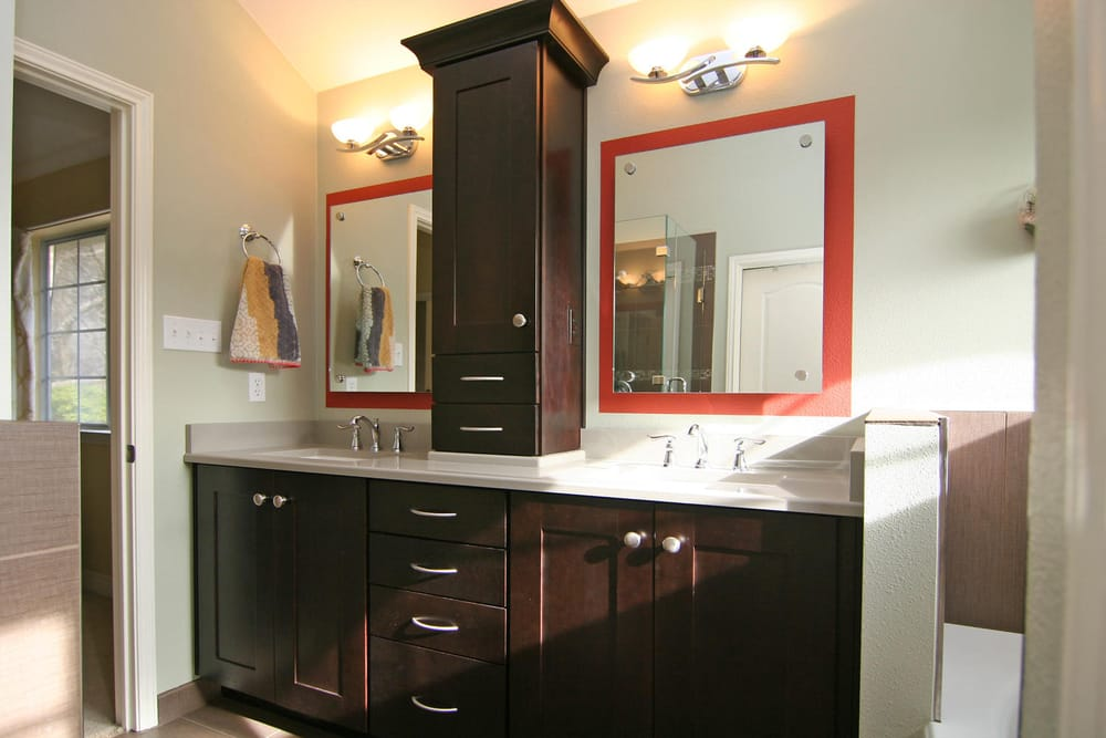 Double vanity with a custom tower cabinet yelp for Bathroom cabinets yelp