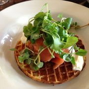 Salmon on potato waffle.