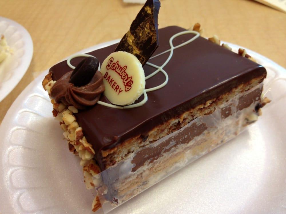 ... hazelnut sponge w/ chocolate truffle & mocha-praline filling topped w