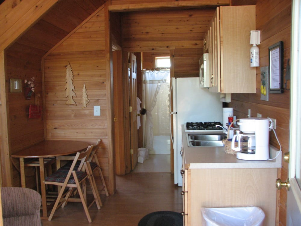 View walking into the cabin kitchen and bathroom yelp for Wooden nickel cabins