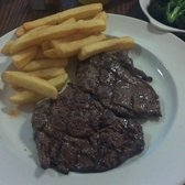 280 grams of Rib eye steak with chips