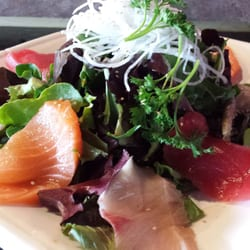 Kai Sushi - Sashimi salad.  2 thick slices each of fresh tuna, yellowtail, salmon and abalone topped over basic lettuce with ponzu sauce. - Poway, CA, Vereinigte Staaten