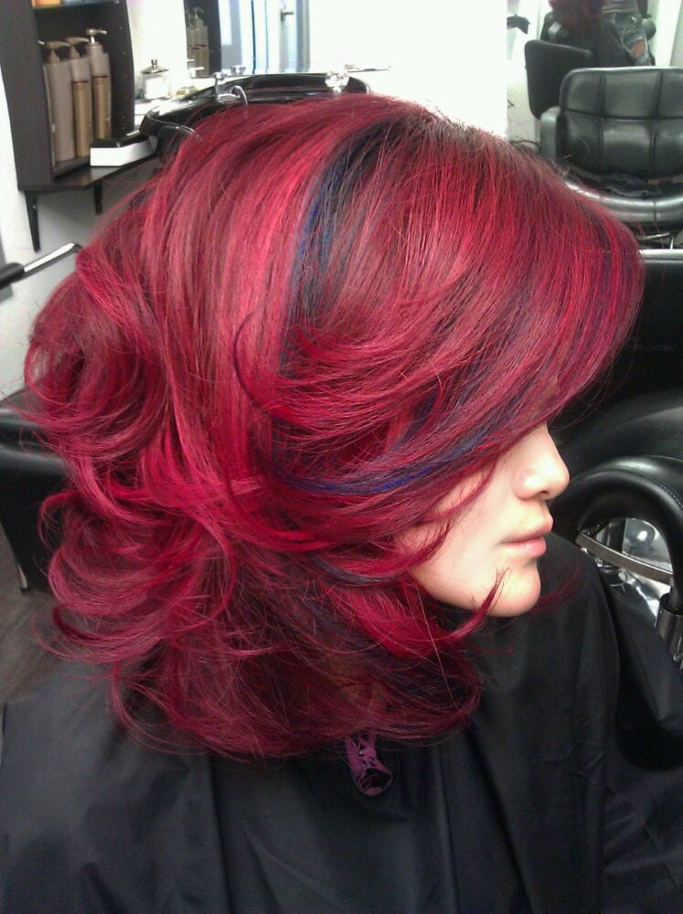 Bright red hair with blue