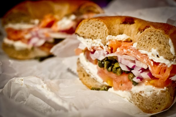 Whole wheat bagel with salmon, cream cheese, capers, onion ...