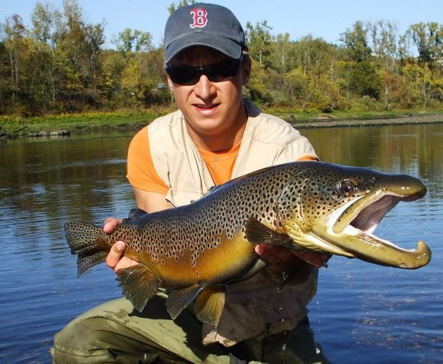 Tj frein white river fishing guide with a huge german for Fishing report near me