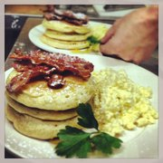 Canadian Pancakes with Crispy Bacon, Maple Syrup and Scrambled Eggs