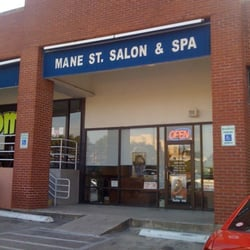 Mane St. Salon & Spa logo