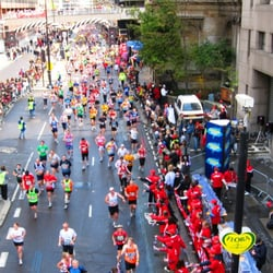 Runners in the 2008 Flora London Marathon passing under the approach to London Bridge on Lower Thames Street.